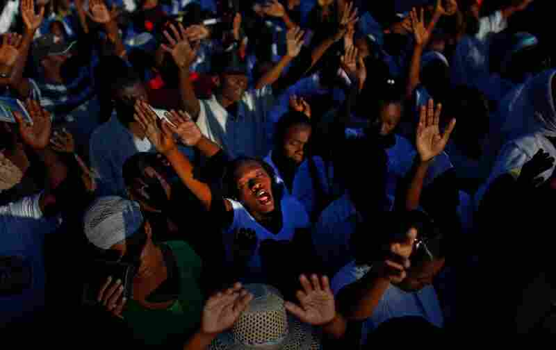 Haitians gather in prayer near the destroyed National Palace in the capital of Port-au-Prince on Wednesday, one year after the earthquake that killed more than 200,000 people.