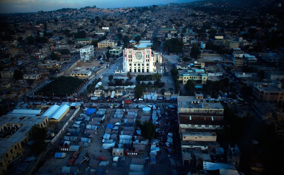 Tents and a destroyed church are seen from above in Port-au-Prince, a year after the earthquake.