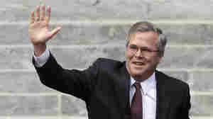 Former Florida Gov. Jeb Bush waves as he is introduced to the crowd during inauguration ceremonies for Republican Rick Scott on Jan. 4 outside the Old Capitol in Tallahassee, Fla. On Thursday, Bush and other Republican leaders are launching a new effort to reach out to Hispanic voters.