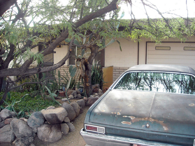 The home in Tucson, Ariz., where Jared Loughner, charged in a shooting that killed six and wounded more than a dozen, lived with his parents.