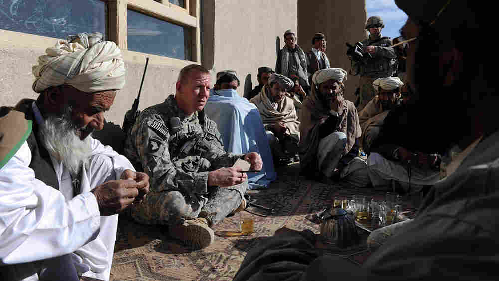 U.S. Army Capt. Aaron T. Schwengler (second left) and other U.S. soldiers of the 3rd Battalion, 187 Infantry, B Company talk with Afghan villagers during a patrol in Bangi village, Andar district in Ghazni province, Jan. 6.