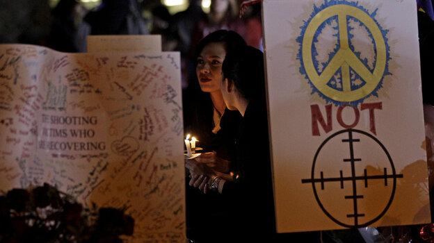 A vigil outside the University Medical Center - Arizona in Tucson, Tuesday, Jan. 11, 2011.
