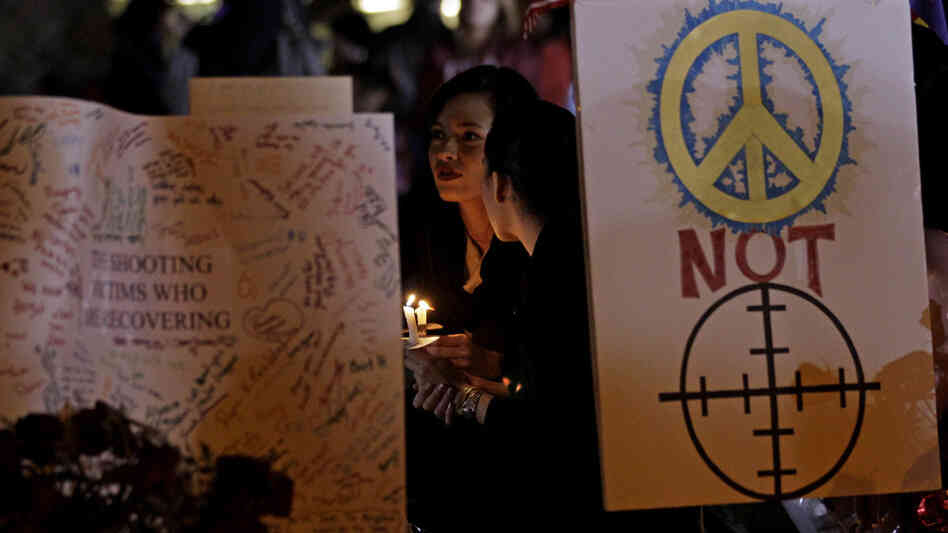 A vigil outside the University Medical Center - Arizona in Tucson, Tuesday, Jan. 11, 2011.