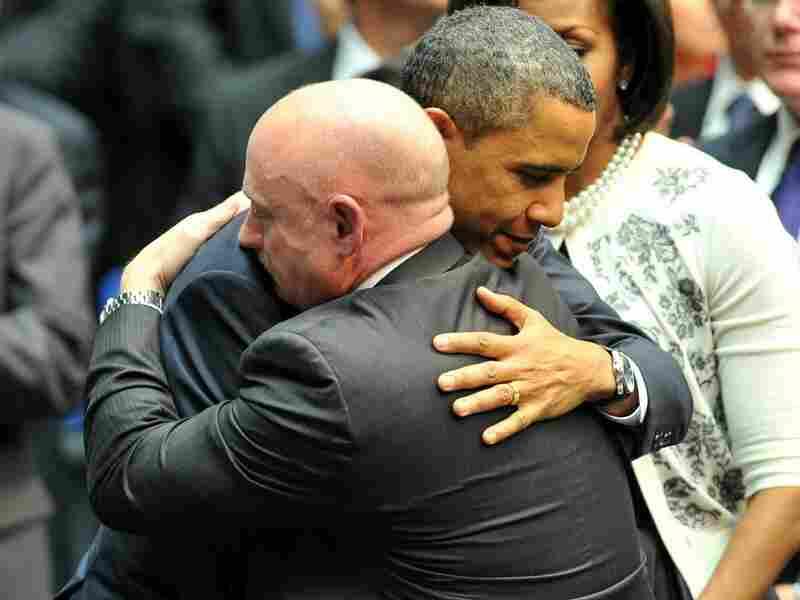 President Obama hugs NASA astronaut Mark Kelly, husband of Rep. Gabrielle Giffords, during a ceremony last week in Tucson, Ariz.