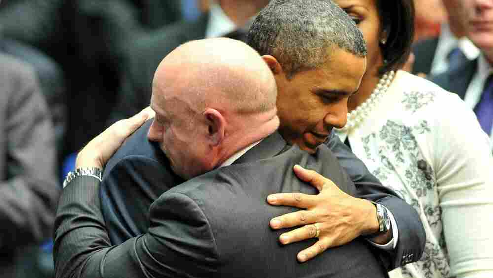 President Barack Obama hugs NASA astronaut Mark Kelly, husband of Rep. Gabrielle Giffords (D-AZ), during a memorial service in Tucson, Ariz., Wednesday.