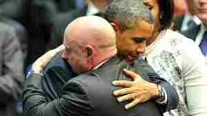 President Obama hugs NASA astronaut Mark Kelly, husband of Rep. Gabrielle Giffords, during a ceremony last week in Tucson, Ariz.