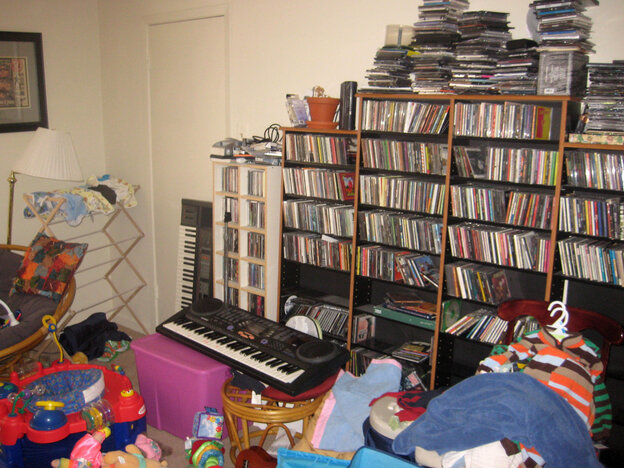 The writer's workspace -- baby toys, baby clothes, keyboards and jams.