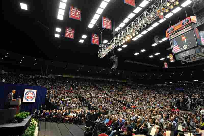 President Obama speaks to a crowd of 14,300 in the McKale Memorial Center, while another 13,000 watch on big screens in the nearby football stadium.