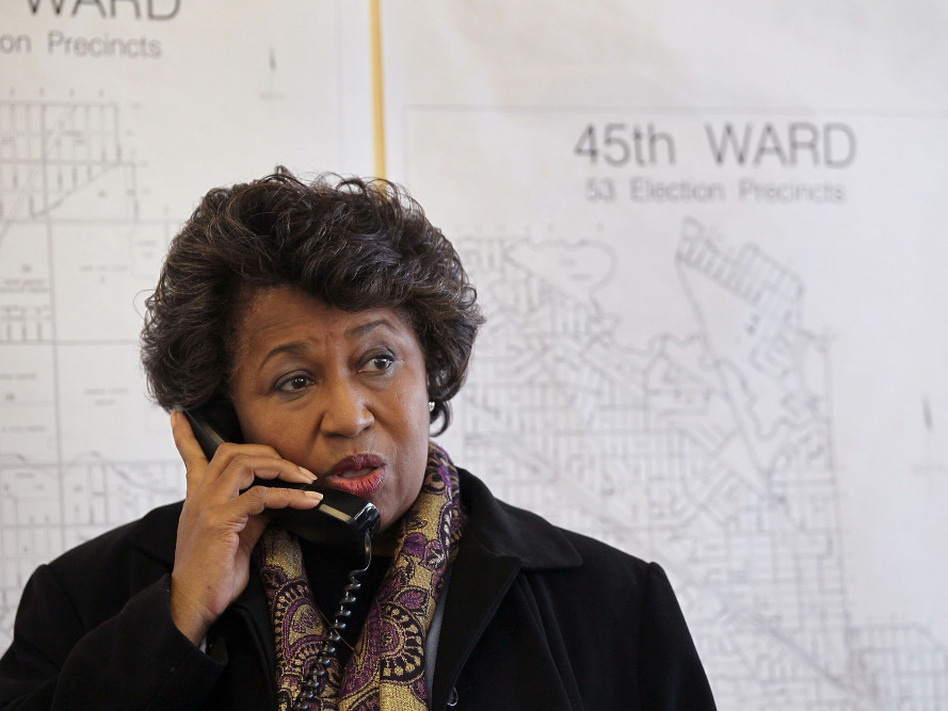 Former U.S. senator Carol Moseley Braun takes a call following a press conference at her campaign headquarters  in Chicago, Illinois. Braun was recently endorsed in her run for mayor by prominent black Chicago leaders.