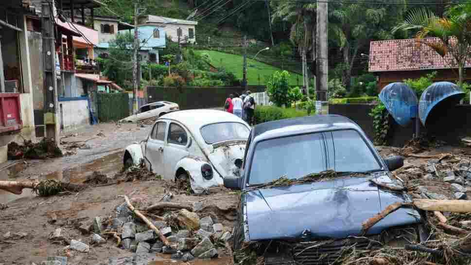 Cars sit in debris in a flooded street in Teresopolis, Rio de Janeiro state, Brazil, on Wednesday (Jan. 12, 2011).