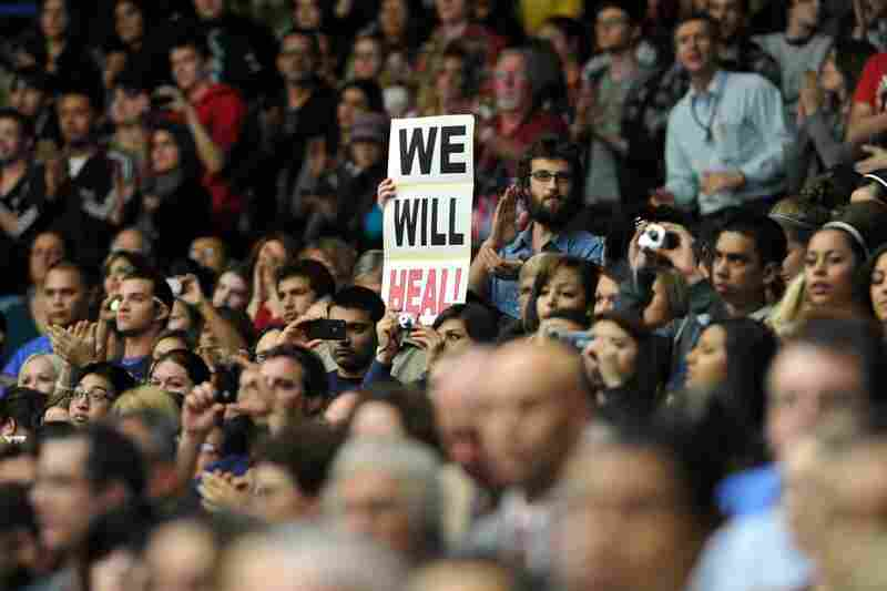"""Thousands crowd into the McKale Memorial Center for the event, dubbed """"Together We Thrive: Tucson and America."""""""