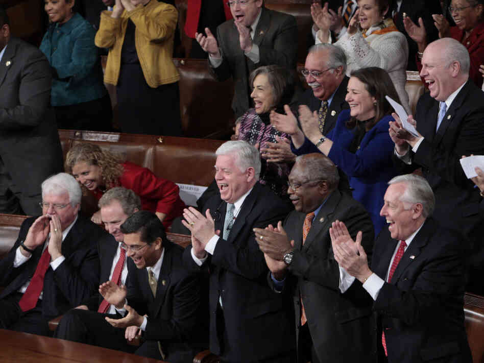 Democrats in their traditionally partisan seating at President Obama's 2010