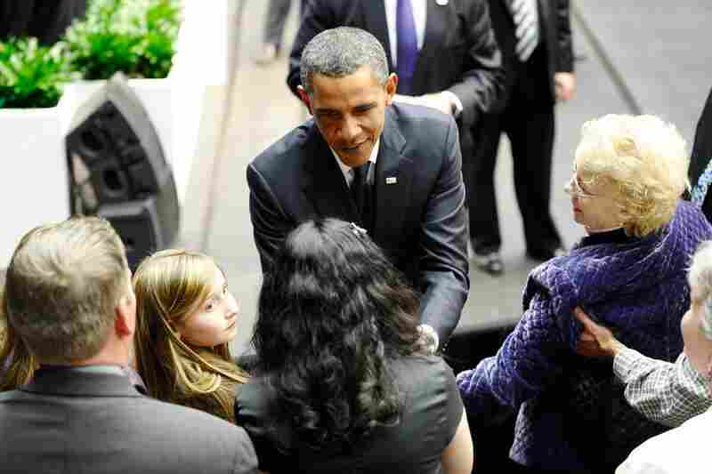 President Obama greets family members of shooting victims during the memorial event.