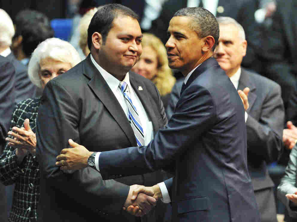 """President Obama shakes hands with Daniel Hernandez Jr., during the memorial event, """"Together We Thrive: Tucson and America,"""" at the McKale Memorial Center in Tucson, Arizona, on Wednesday (Jan. 12, 2011)."""