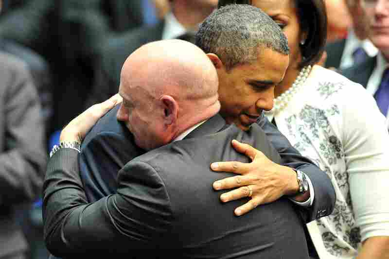 President Obama hugs NASA astronaut Mark Kelly, husband of U.S. Rep. Gabrielle Giffords, who remains hospitalized after being shot Saturday.