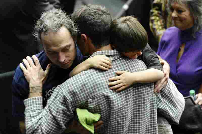 A group mourns during the service.