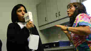 Nurse Maria Aguilar encourages teenager Jesus Ayala during a test of his lung capacity at a Los Angeles clinic in 2007.