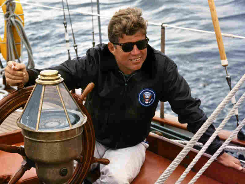 President Kennedy sails aboard the  Manitou off the coast of Maine, Aug. 12, 1962.