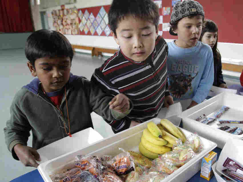 Second-grader Jonathan Cheng eyes fruits and vegetables during a Farimeadow Elementary School in Palo Alto, Calif., last month.
