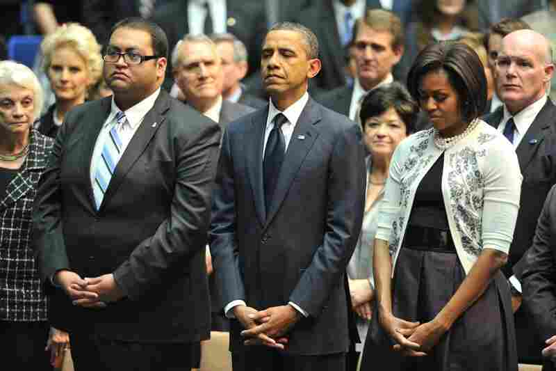 The Obamas stand next to Giffords' intern, Daniel Hernandez, who was honored as a hero at the event. Arizona Gov. Jan Brewer said Hernandez's quick actions probably saved Giffords' life. Hernandez rushed to help the congresswoman after she was shot.
