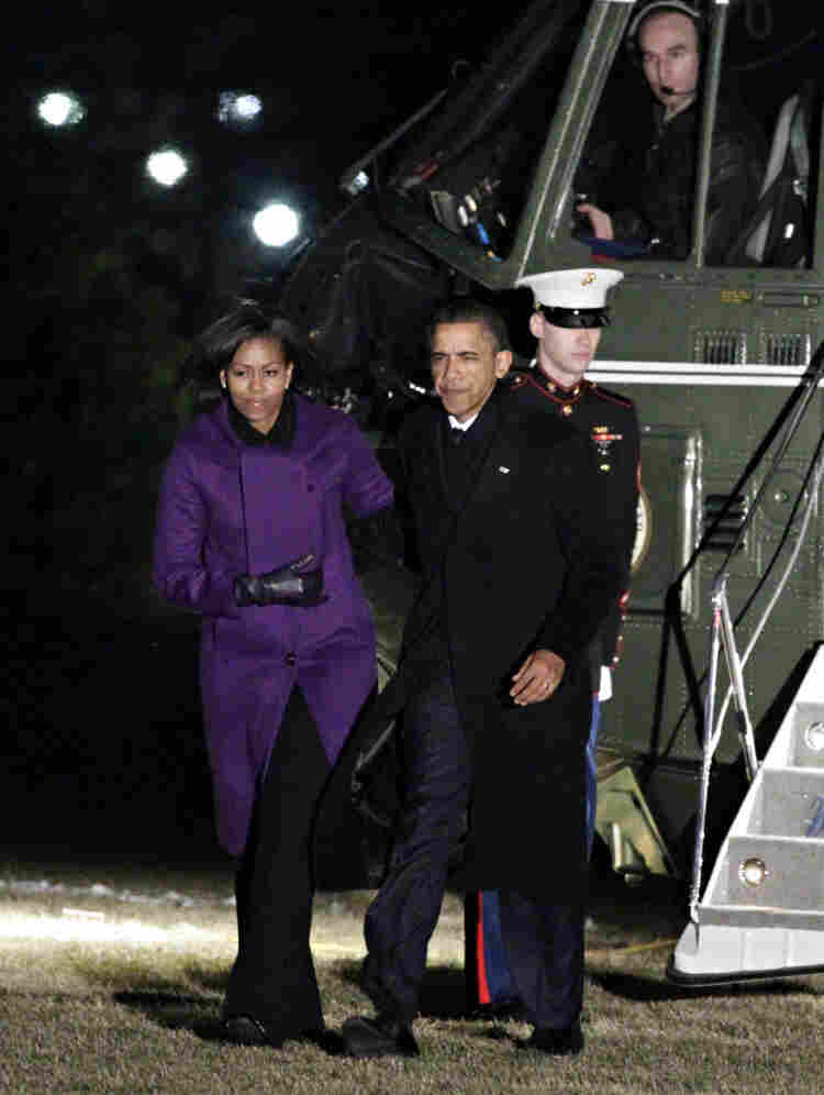 President Obama and first lady Michelle Obama return to the White House from Tucson.