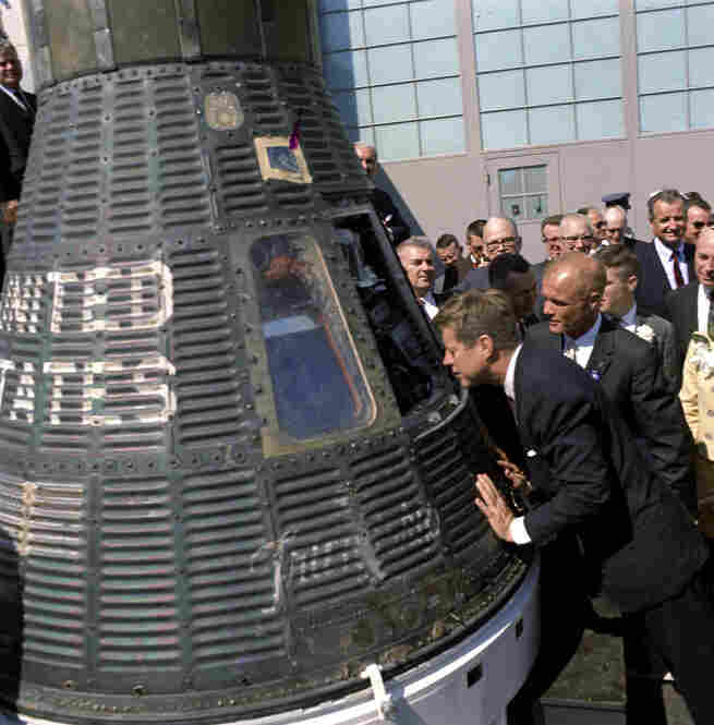 President Kennedy gets a look inside the Mercury capsule that was piloted by John Glenn (at Kennedy's right) on Feb. 23, 1962.
