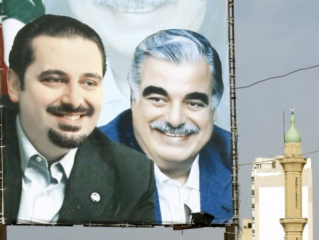 A poster of outgoing Lebanese Prime Minister Saad Hariri and his assassinated father, former Prime Minister Rafik Hariri, decorates a street in the southern Lebanese city of Sidon. The militant Shiite group Hezbollah has forced the creation of a new government after members pulled out of the Hariri-led national unity government.