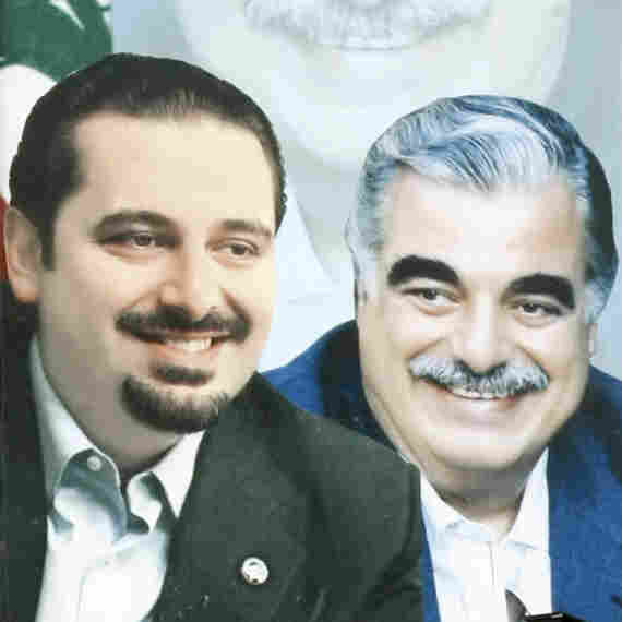 A poster of outgoing Lebanese Prime Minister Saad Hariri and his assassinated father, former Prime Minister Rafik Hariri, decorates a street in the southern Lebanese city of Sidon, Jan. 14, 2010.