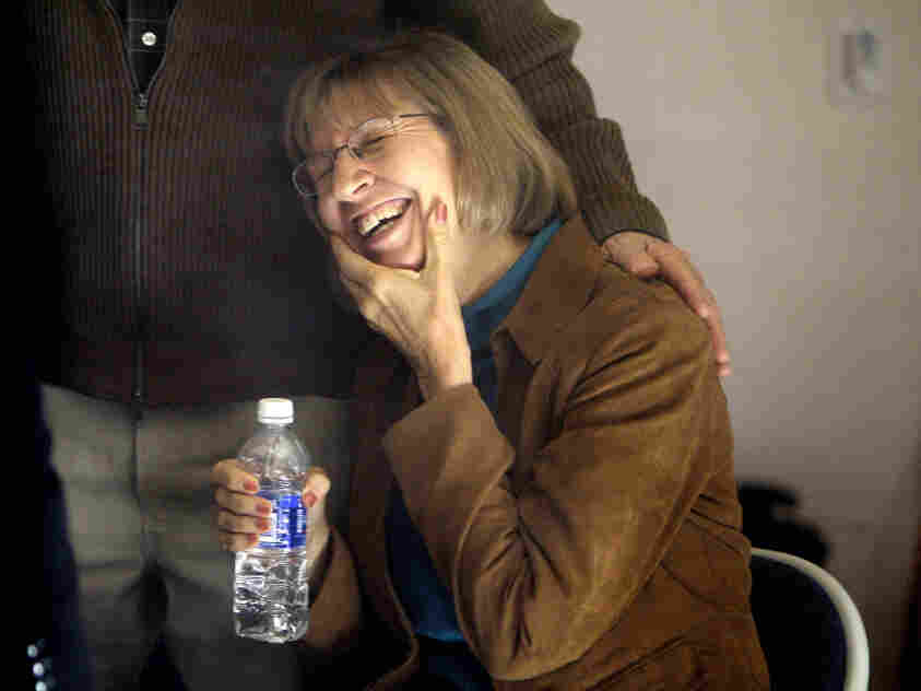 Pam Simon, an outreach coordinator for Rep. Gabrielle Giffords, smiles as she visits the congresswoman's Tucson office Friday only days after being shot in the wrist and chest during the rampage that critically injured Giffords. Nineteen people were shot, six fatally.