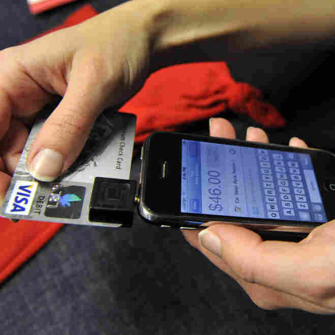 In this Dec. 18, 2009, photo, Willo O'Brien demonstrates Square on her iPhone in San Francisco. O'Brien, a designer and illustrator, uses Square for credit card transactions with her customers. Users can sign for purchases by writing with a finger on the iPhone's touch screen.
