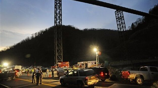 West Virginia State Police direct traffic at the entrance to Massey Energy's Upper Big Branch coal mine in Montcoal, W.Va., on April 5. (AP)