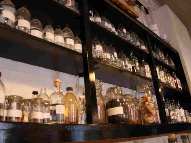 Jars of spices sit along a shelf, waiting to flavor Sipsmith's gin.