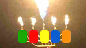 Each jet of flame correspondes to one of the colored buttons on a Guitar Hero contoller.
