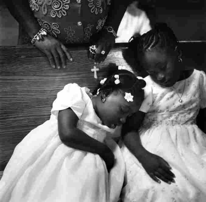 Girls at mass, Notre Dame D'Haiti Catholic Church, Little Haiti, Miami, Florida, 2003