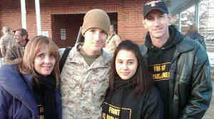 Lance Cpl. Josh Apsey (second from left) takes a minute for one last photo with his wife, Carolyn (second from right), and parents, Vicki and Tom, before heading back to Afghanistan.