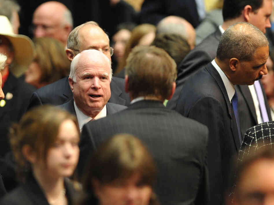 Sen. John McCain arrives to attend the Tucson memorial event, on January 12, 2011.