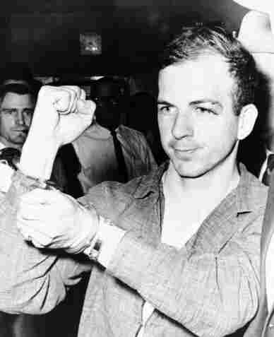 Lee Harvey Oswald, a former Marine, assassinated President John F. Kennedy in Dallas, on Nov. 22, 1963, with three high-powered rifle shots, according to the findings of the Warren Commission.