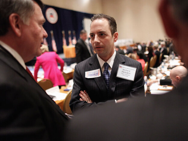 Reince Priebus talks with members during the Republican National Committee meeting on Friday in Oxon Hill, Md. Priebus was selected as RNC chairman after seven rounds of voting.