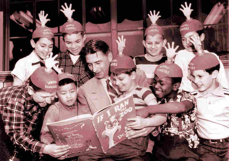 Dr. Seuss reads to the cast.