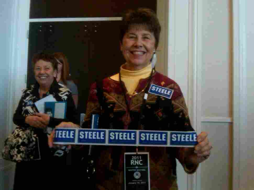 Woman with Michael Steele bumper stickers.