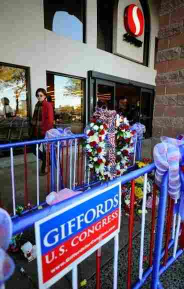 TUCSON, AZ - A makeshift memorial in front of the supermarket where U.S. Rep. Gabrielle Giffords (D-AZ) was shot in the head. The mass shooting killed six and injured several others.