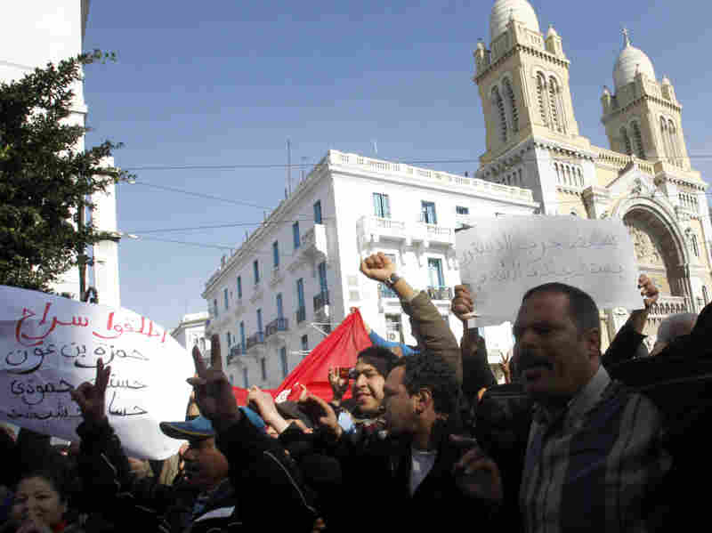 Protesters shouted slogans against former Tunisian President Zine El Abidine Ben Ali during a demonstration Monday in the center of Tunis.