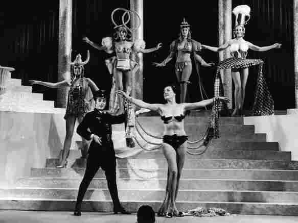 Actors and chorus girls perform on stage in German-themed costumes during the 'Springtime For Hitler' musical number in the film, 'The Producers,' directed by Mel Brooks, 1968.