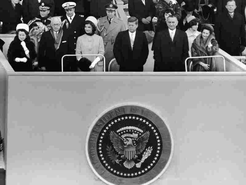 John F. Kennedy stands on a platform for his inauguration on the east front of the U.S. Capitol on Jan. 20, 1961, accompanied by his parents, Rose and Joseph Kennedy, First Lady Jacqueline Kennedy, Vice President Lyndon Baines Johnson and his wife, Lady Bird Johnson.