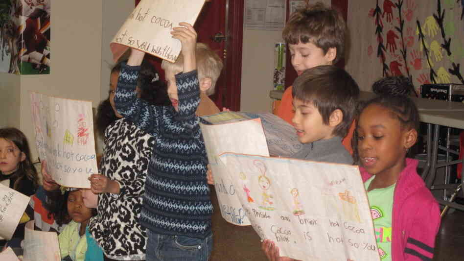 Pre-kindergarten through third grade students recite poems in English and Chinese.