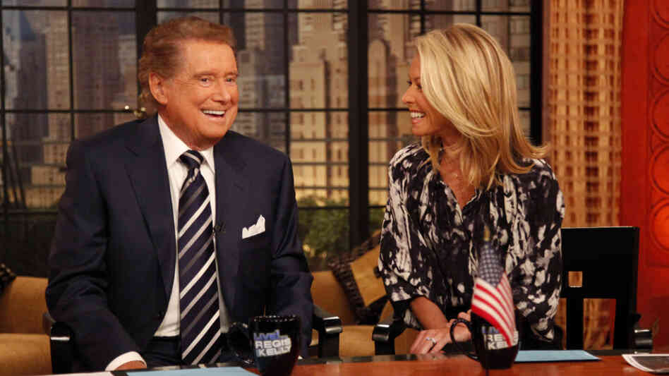 Host Regis Philbin, left, laughs with co-host Kelly Ripa on the set of Live with Regis and Kelly in January 2010, shortly after Philbin returned to the show after undergoing hip replacement surgery.