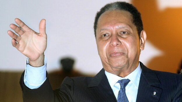 Jean-Claude Duvalier, the former Haitian leader known as 'Baby Doc', waves to supporters from a balcony of the Hotel Karibe on January 16, 2011 in Port-au-Prince,