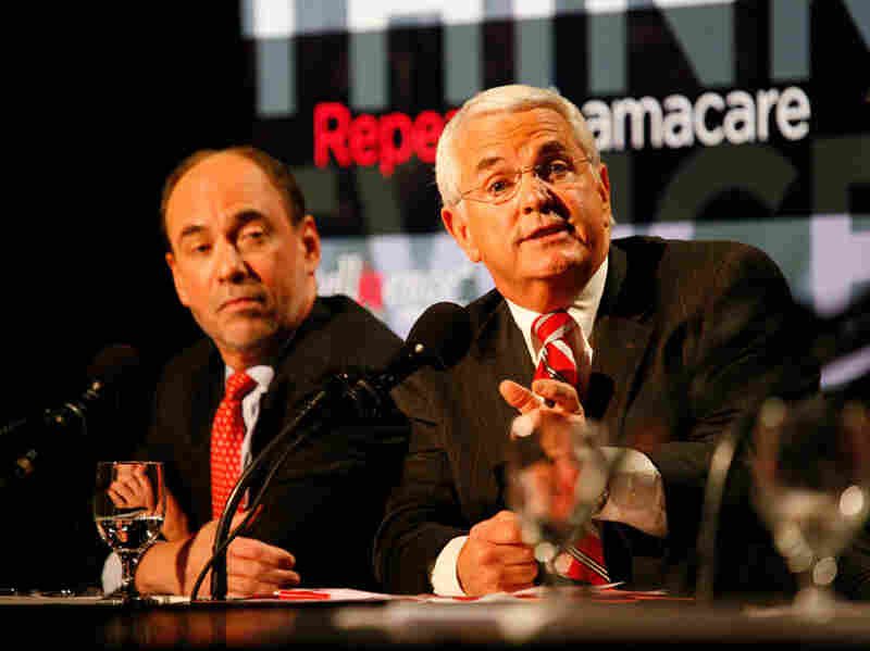 Douglas Holtz-Eakin (left) and John Shadegg debated in favor of repealing the new health care law.