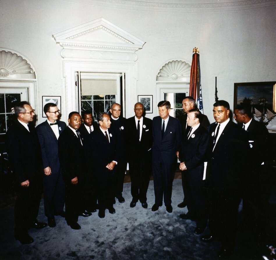 President Kennedy meets with the leaders of the March On Washington in the Oval Office on Aug. 28, 1963. At the meeting were (from left to right)  Labor Secretary Willard Wirtz, Mathew Ahmann, Rev. Martin Luther King Jr., John Lewis, Rabbi Joachim Prinz, Rev. Eugene Carson Blake, A. Philip Randolph, President Kennedy, Vice President  Lyndon Johnson, Walter Ruether, Whitney Young, Floyd McKissick.  (John F. Kennedy Presidential Library/NPR)