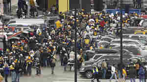 Fans tailgate outside Heinz Field in Pittsburgh before an NFL divisional playoff football game between the Baltimore Ravens and Pittsburgh Steelers, Saturday, Jan. 15, 2011.